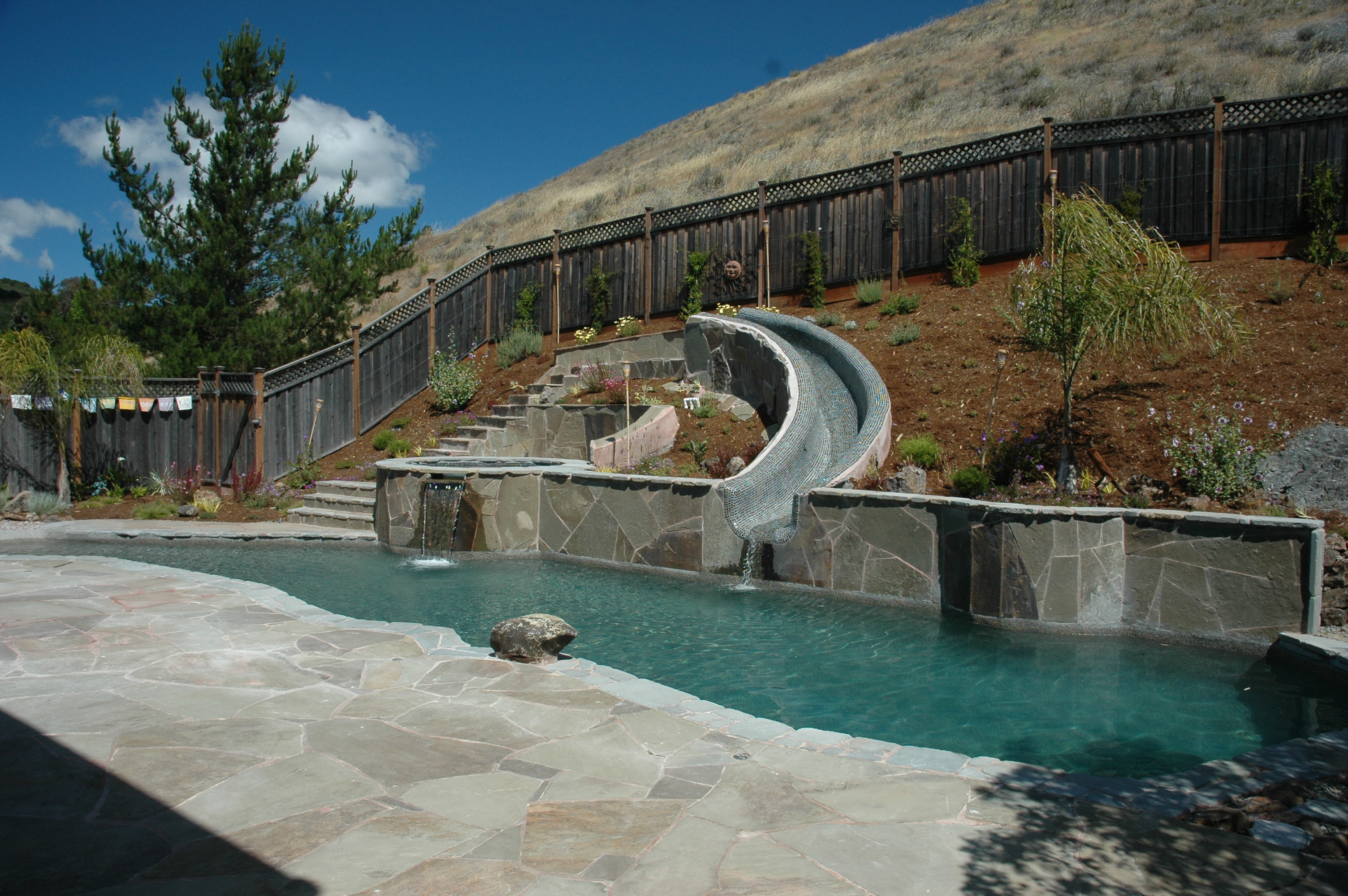 Blue water pools swimming pool builders pool services for Swimming pool construction