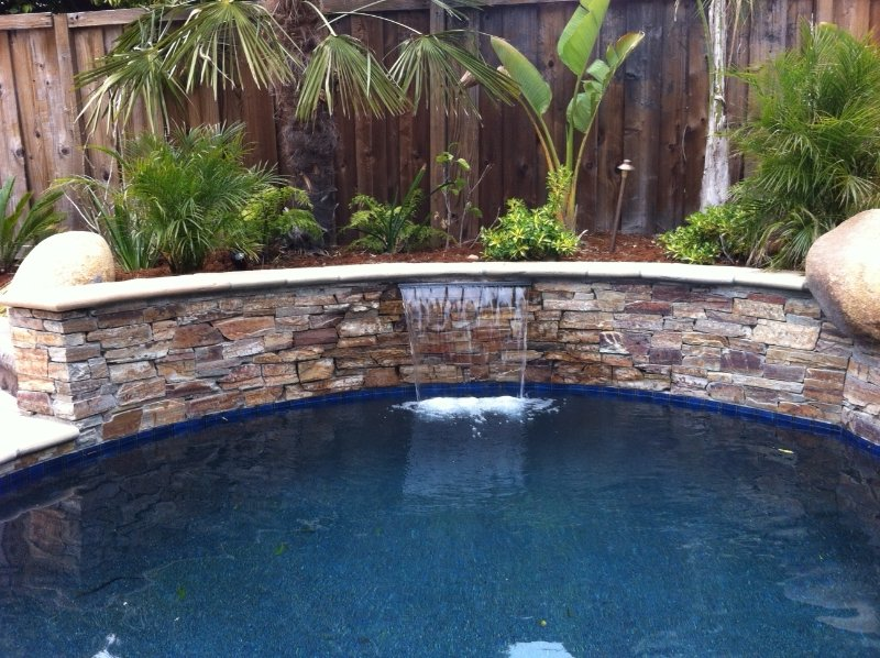 Water features blue water pools for Swimming pool water features